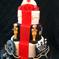 Red Carpet Nursing Going away cake for a beloved nurse. Film reel is gumpaste and has edible gelatin film on it. Clap board is gumpaste and was inspired by...