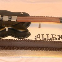 Guitar Everything edible except the neck of the guitar is foam board covered with fondant. Dark chocolate/chocolate chip with dark chocolate...