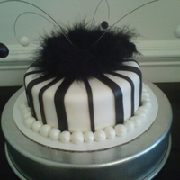 "Black & White Striped Cake 10"" French Vanilla Cake with Black Stripes & feather boa"