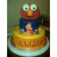 Elmo Cake 2 tiered Elmo cake. Tiers are covered in fondant. Elmo's head is krispy treats.