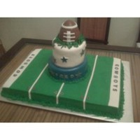 "Dallas Cowboys Football Cake Full sheet cake with 8 and 6"" tiers covered in fondant. Football is made of krispy treats. Field is buttercream with fondant accents...."