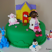 Doc Mcstuffins Cake!   Vanilla cake with chocolate buttercream filling.House is made of Rice KrispiesTreats, covered in fondant.Characters are gumpaste.
