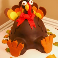 Tom The Turkey  I saw a picture of a similar design on the internet, but no credit was given to the decorator who made it. If this looks similar to a cake...