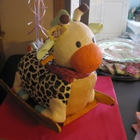 Raffi The Giraffe A cake made for my brother and sister-in-law's baby shower. Sorry for the bad photo! Meant to resemble the rocking horse giraffe that...