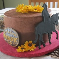 Western Birthday Cake This is an idea heavily borrowed from Cakes by Roselyn on flickr. Gumpaste horse/rider, sunflowers, and belt buckle. Fondant was textured...
