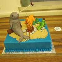 Turtle And Narwhal A silly birthday cake with a turtle and a narwhal roasting weenies and marshmallows over a pulled sugar campfire. Thanks DianeLM and K8 for...