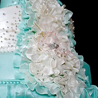 Tiffany Blue Wedding Cake Cake for 150, Tiffany Blue and White with dragees. Sprayed with luster, all edible ribbon work. One layer was hexagonal.