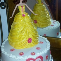 Barbie Princess Cake Belle Beauty And The Beast Beauty and the Beast Belle cake. Barbie i the middle skirt is cake and draped in fondant.