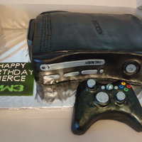 Xbox 360 Modern Warfare 3 devils food cake with chocolate ganache filling, crumb coated in chocolate ganache, and covered in fondant. Air brushed in black, controler...