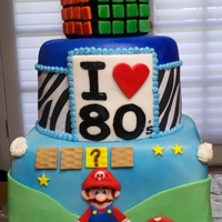 80's Themed Cake, Rubix Cube, Mario Bro This is an 80's themed cake for a coworker who loves the 80's, Ribix cbe is rice crispy treat covered in chocolate, and fondant....