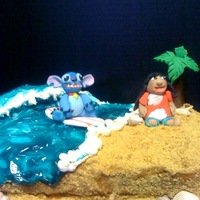 Lilo And Stitch...   Lilo and Stitch... characters all made in fondant... graham cracker sand and piping gel sea...