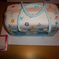 Purse Cake With Cell Phone 2 tiers.....6 layers....bottom of both is....mint chocolatemiddle of both is....vanillatop of both is....strawberrycovered in fondant....