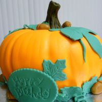 Pumpkin Cake Chocolate cake covered in buttercream and MMF.