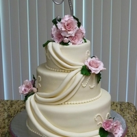 Ivory Cake And Pink Roses   Ivory cake with drapes and pink roses