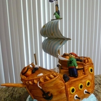 Pirate Ship Cake   Fondant covered cake. The sails are scrapbooking paper that looks like fabric.