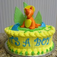 Baby Triceratops Cake   Vanilla cake covered in buttercream. Dino figurine is made out of MMF