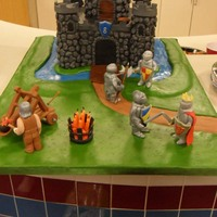 "King Will And His Knights Another cake for another nephew. He wanted knights fighting in front of a castle. The 8"" square castle is covered with BC rocks and..."