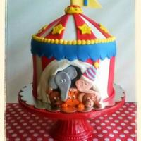 Circus Theme First Birthday Cake All chocolate cake...including the tent top. Whipped ganache filling and chocolate fudge buttercream under white fondant. Fondant figures...