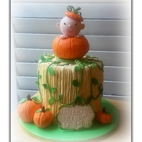 "Little Pumpkin Baby Shower Cake An 8"" double barrel spice cake with cream cheese frosting. Topper and pumpkins made out of Rice Krispie treats covered in fondant as..."