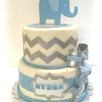 Elephant And Chevron Baby Shower Cake For Boy My interpretation of an apparently very popular design. Kudos to the original designer! I did add silver luster dust to the grey for shine...