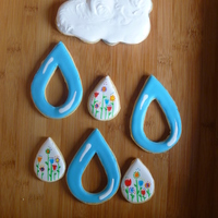 "This One Goes With The April Showers Bring May Flowers Cookie Setthese Are Puzzle Cookies Where The Flower Raindrops Were Supposed To This one goes with the ""April Showers bring May Flowers"" cookie set...These are puzzle cookies, where the flower raindrops were..."