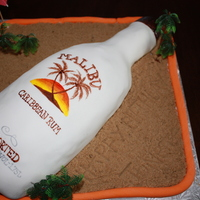 Malibu Rum Cake This was for a friends birthday and she loves Malibu Rum. Hand drawn label with covered fondant. Sand is just brown sugar.