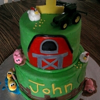 John Deere Cake This was for a little buddy of mine. It was his first birthday and his name was John of course.
