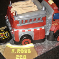 Farewell Fire Truck Cake Quickly made this for one of the guys retiring from our town's fire department. Chocolate cake w/ strawberry filling. Covered and...