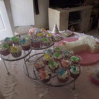 1St Birthday Cupcakes I made the butterflies from gumpaste.