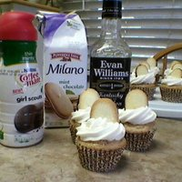 Kentucky Derby Mint Julep Cupcakes  soaked pecan pieces overnight in bourbon, then folded them into butter pecan cake. Girl Scout Thin Mints creamer and Milano mint cookies (...