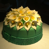 Calla Lillies Gumpaste Calla Lillies. It was an 1 year anniversary cake. The wedding flowers were calla lillies and the colors were kelly green and...