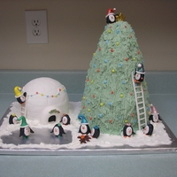 A Penguin Christmas Penguins decorating Christmas tree and their igloo!
