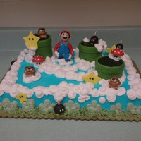 Mario Brothers Cake With Hand Made Figures Mario and the creatures & stars are made with fondant and tylose powder. Pipes are rice krispy treats.