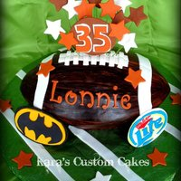 Brown's Birthday Cake Cleveland Brown's themed birthday cake. Carved 3D Football, hand-painted. Gumpaste accents, Miller Lite Logo and Batman Logo. TFL...