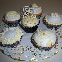Wedding Cupcakes I'm practicing for a friends wedding. Very small affair and I'm making cupcakes. All buttercream and RI
