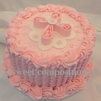 Pretty In Pink Petal icing technique from mycakeschool.com. Fondant cross and small flowers