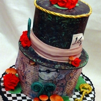 The Hatter Sweet 16, wonderland themed. Inspired by so many wonderful Mad Hatter cakes out there!