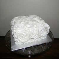 Roses Birthday Cake White Almond Sour Cream Cake with Strawberry Filling and Vanilla Buttercream.