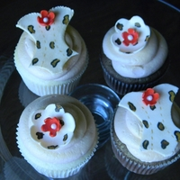 Leopard Corset Cupcakes Hand painted fondant corsets and flowers. WASC cupcakes and Chocolate cupcakes with vanilla buttercream. Sprayed Gold, but camera didn'...