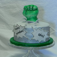 Incredible Hulk WASC with cherries mixed in and vanilla buttercream. Fist is RKT covered in fondant, all fondant decorations and hand painted comic bubbles...