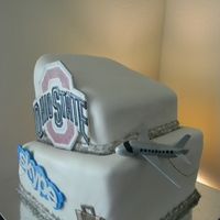 Travel Theme Engagement Cake This was my first Topsy Turvy cake .. so glad it's over!! LOL Bride wanted the Ohio State Logo, Skype Logo and Travel Theme...
