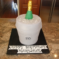 "Champagne Bucket 10"" round on top of a 6"" high tapered cake dummy. Covered in buttercream and fondant. Isomalt (thanks Rosie!!!!) ice and the..."
