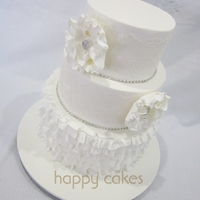 All White Wedding... I made this 3 tier cake recently for a bride. She'd seen a previous design of mine but wanted to change a few things.