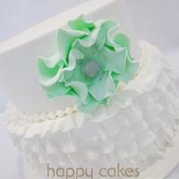 Ruffle Wedding Cake I made this simple yet pretty cake for a recent bride. I love the colour of the flower!