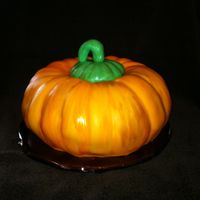 Painted Pumpkin Chocolate cake with buttercream icing, topped with orange colored fondant. i also painted the fondant with vodka and orange food coloring,...