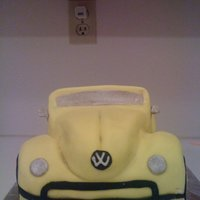 Vw Beetle (Old Model) carved cake. froze and carved, crumb coated, covered in marshmallow fondant.