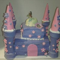 "Princess Tiana Castle Cake Birthday cake for a friends daughter. 8""square and hand cut 4"" square. Bottom Tier white cake top cake chocolate fudge cake both..."