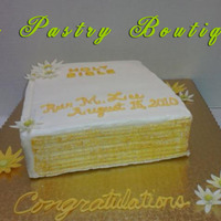Bible Cake Yellow cake with strawberry filling and vanilla buttercream. Daisies are fondant/gumpaste. Pages painted with gold luster dust. This was a...