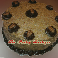 German Chocolate 12 in German Chocolate Cake with Raspberry Ganache decorations.