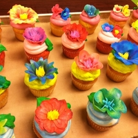 Tropical Flowers first time playing with gumpaste flowers. cupcakes are all tropical flavors